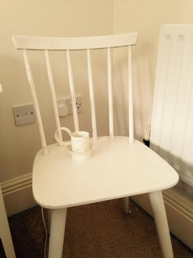 I bought this chair from Oxfam last year...and the candle holder come to think of it. I love the shabby chic feel it gives to the room.